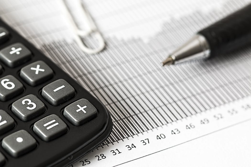 Tax Accountant's calculator and balance sheets