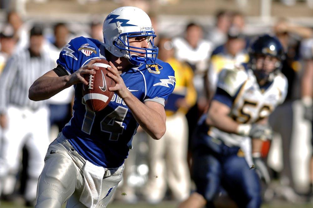 football player holding a football ball