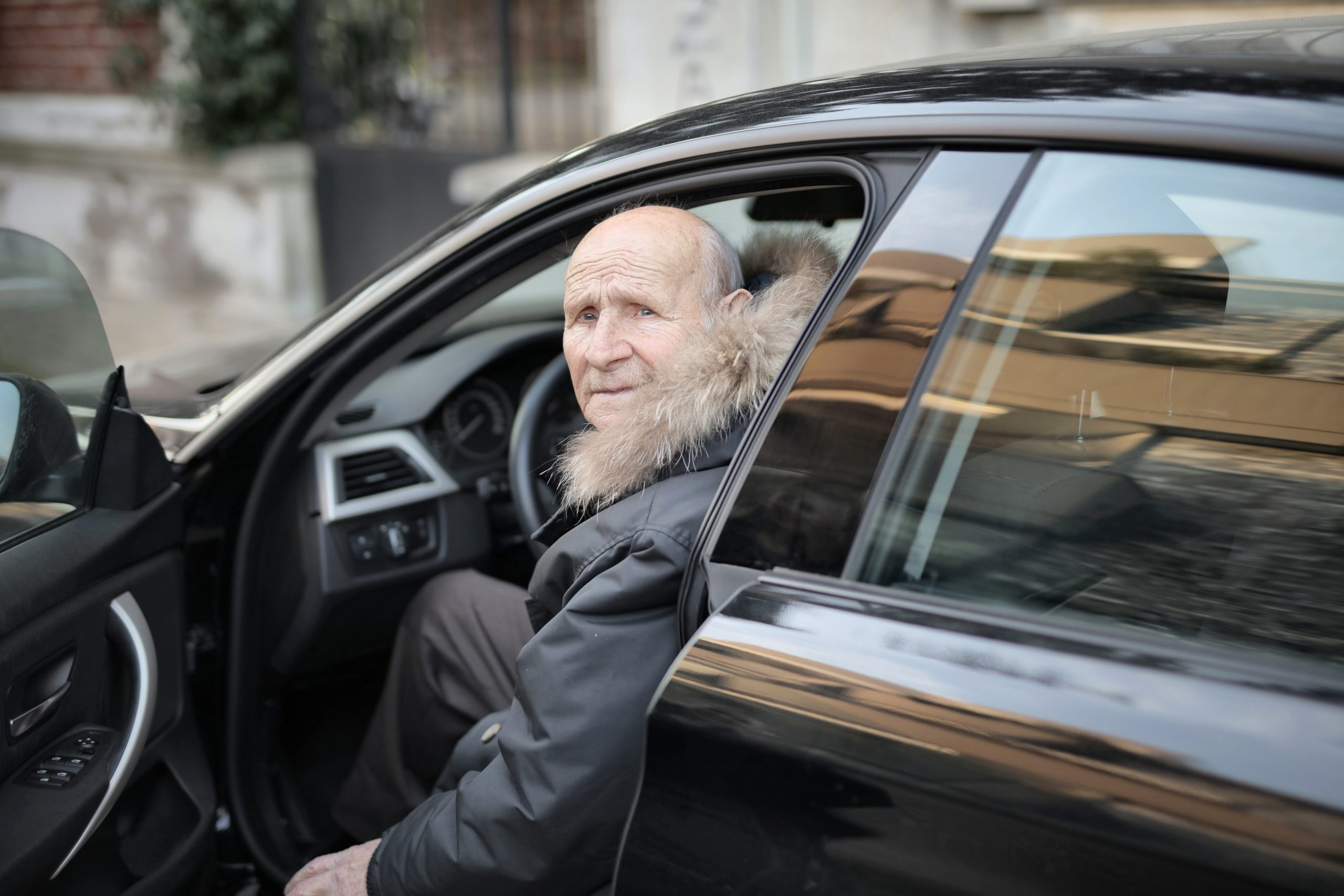 Old man in a car about to start his driving with dementia test