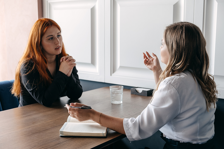 Woman meeting a holistic therapist to cope with emotional difficulties