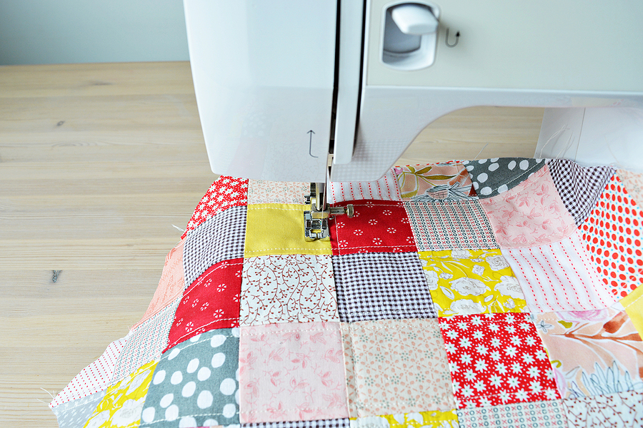 Quilting process. Quilt and a sewing machine