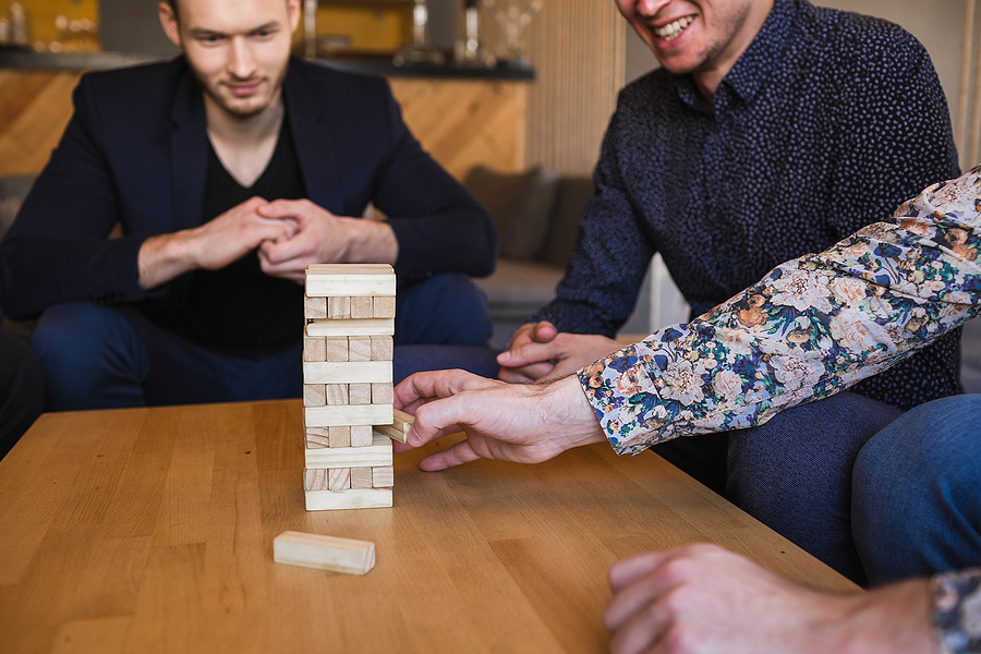 Group of employees playing board games during team building events