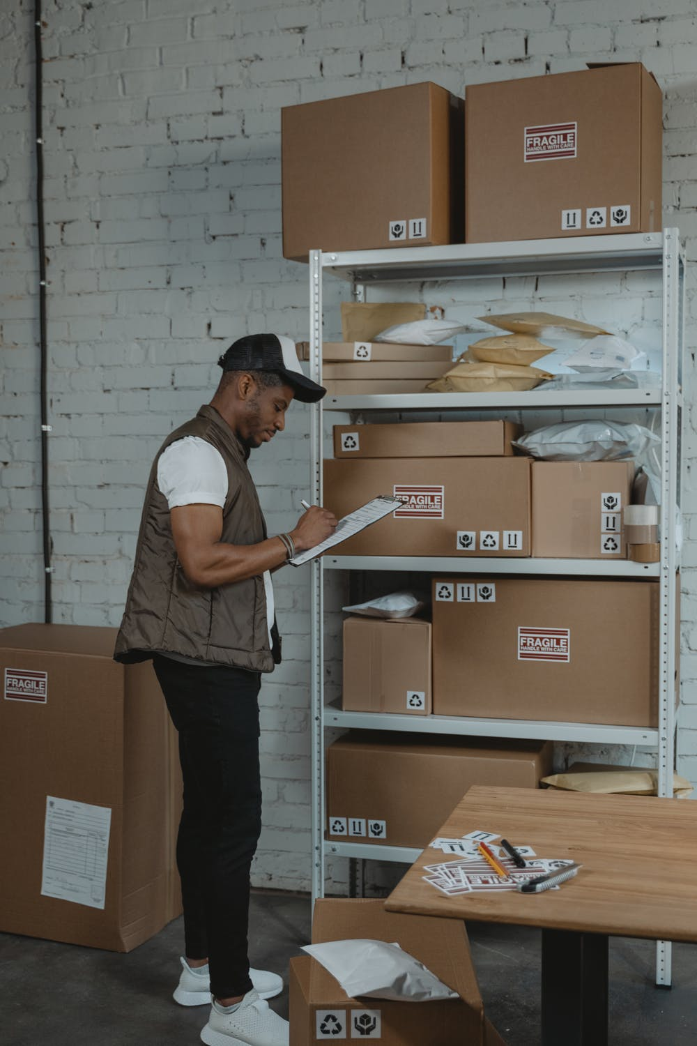Male worker doing inventory inside a 3PL warehouse