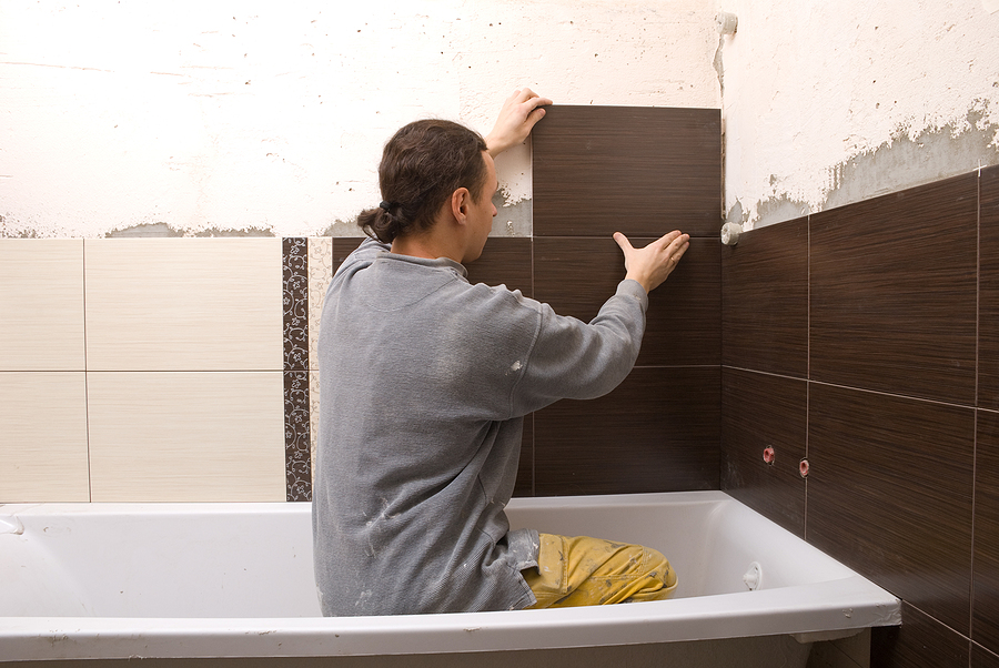 Worker while doing a bathroom renovation in Sydney
