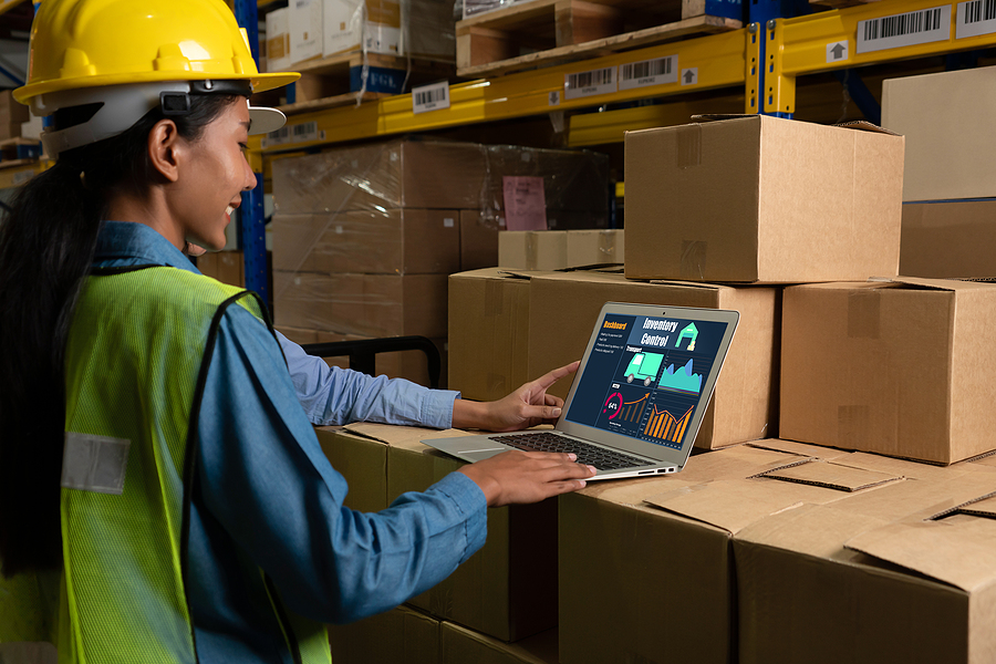 Warehouse worker using a MYOB advanced software