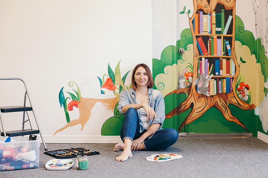 Female mural painter